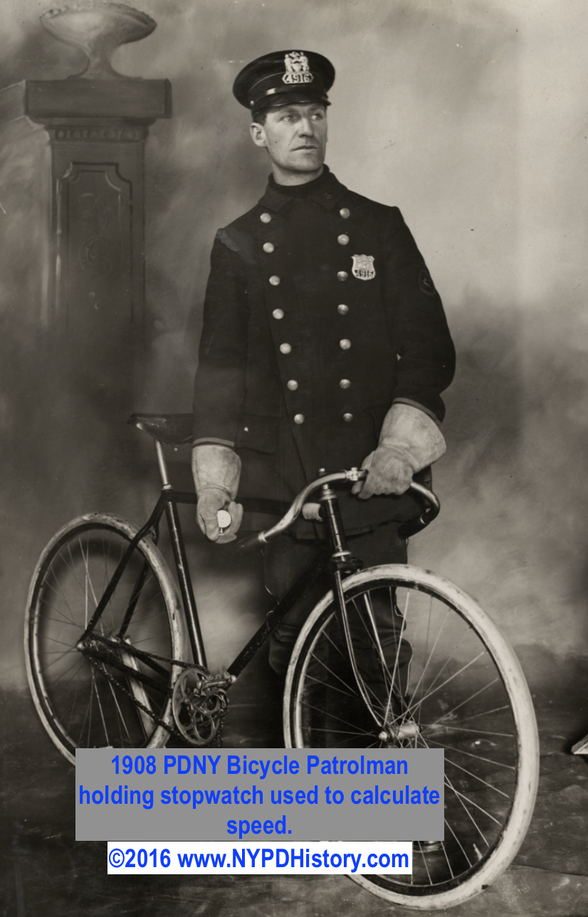1908 Bicycle Patrolman holding stopwatch used to compute speed.